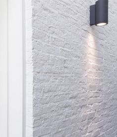 White washed brick, sconce