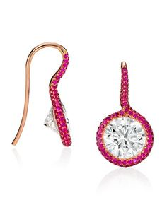 A glamorous alternative to the classic diamond stud, these Diamond and Ruby Twist Earrings each feature 2 carat round brilliant cut diamonds. Price on application.