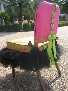 """This is my """"Rock Star Chair Suit®. The jacket is shown in candy pink with black grommets, laced with apple green satin ribbon and trimmed in a pink and green zebra print band. The chair skirt is made in pink and green zebra print for both seat and band, with a layered black tulle Tu-Tu and black satin ribbons to tie onto chair. Both jacket and skirt are lined in 100% cotton lining. Each set is created to custom fit your chair.  Dry clean only."""