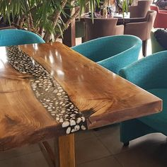 Walnut transparent black epoxy resin with river pebbles, natural stone hart and LED light dining table.
