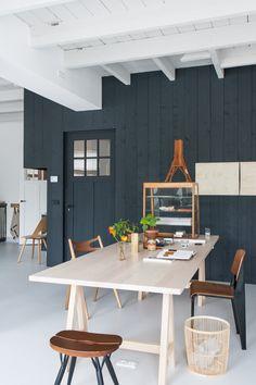 Wooden dining table / work desk in the fabulous studio of interior designer Christien Starkenburg.
