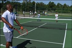 MaliVai Washington and students officially open the courts with the First Serve