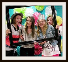 Loving this photo booth idea for a Sweet 16 party @ Tater Tots and Jellow. She used plastic tablecloths for the backdrop and then added the tissue paper flower pompom things. They took pics with the frame and without!