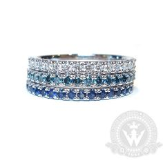 Custom crafted by Sara and Daniel at our workshop in Weiss Jewelry in Los Angeles: 14k White Gold 'U-Pave' Eternity band stack. Featuring White Diamonds Blue Diamonds and Blue Sapphires this stack was a gift for a new mommy who's daughter's name means water! Congrats to this beautiful family!! #handmade #handcrafted #handfinished #handset #diamonds #pirlanta #stackablerings #stackablebands #stacks #weissjewelry #ring #eternityband #finejewelrydesigner #microsetting #engraving #wedding…