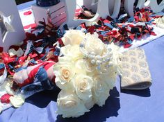 Imprint Affair adds a touch of whimsy to the bridal bouquet by using an American flag scarf for the bride's something blue.  Sweetheart table and bouquet designed by Imprint Affair.