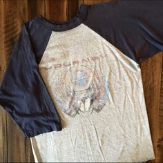 1981 Journey Tour Raglan Still not sure if I want to sell this one, price firm for now. Authentic Journey concert tee, raglan/baseball style, super soft & thin! Seen on Freaks & Geeks!  BRAND: - MATERIAL: 50/50 YEAR/ERA: 1981 LABEL SIZE: L BEST FIT: M  MEASUREMENTS: Chest 19 inches  Length 26-28 inches rounded hem  🚫 Trades 🚫 Modeling 💟 Check out my closet for more vintage tees! Vintage Tops Tees - Long Sleeve