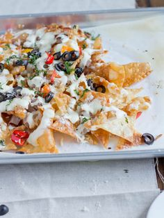 Italian nachos with fried wontons, Alfredo sauce, mozzarella, and other yummy goodness.