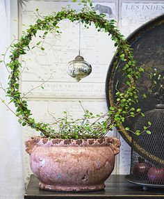 Love this idea of creating a wreath and hanging a small, light ornament from it.  So many ideas to use this with!