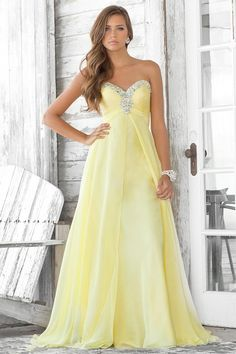 lemon meringue strapless sweetheart floorlength evening gown, tanned skin, waistlength wavy caramel locks