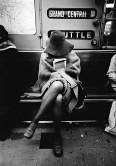 A woman on the subway, New York City, 1970s.