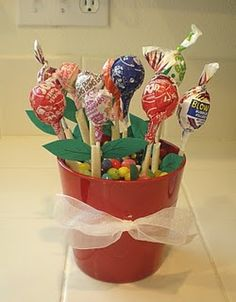 Candy bouquet, cute gift! A mug filled with candys to hold up lollipops