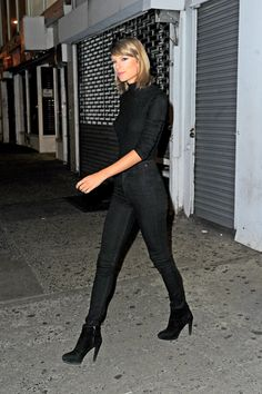 All black: a turtleneck, high-waisted denim, and suede ankle boots.