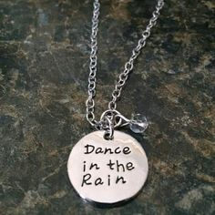"""Dance in the rain silver necklace pendant NWOT!! I own a small at home business and am trying to clear out some stock. Dance in the rain pendant measures 3/4"""". Clear crystal dangle attached as well. On an 18"""" silver chain with 2"""" extender. Costume jewelry, not sterling silver. Any questions, just ask! Jewelry Necklaces"""
