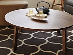 A round coffee table that provides a generous top for serving guests. The STOCKHOLM collection, 2013.
