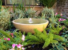 If I did this correctly this should be a tutorial on making a garden fountain.  Good instructions and I love the vessels they used.