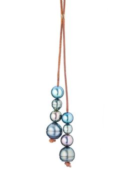 "8 PEARL ON LEATHER CORD MEASUREMENTS: LENGTH: 36"" PEARLS: .25"" - .5"" APPROXIMATELY"