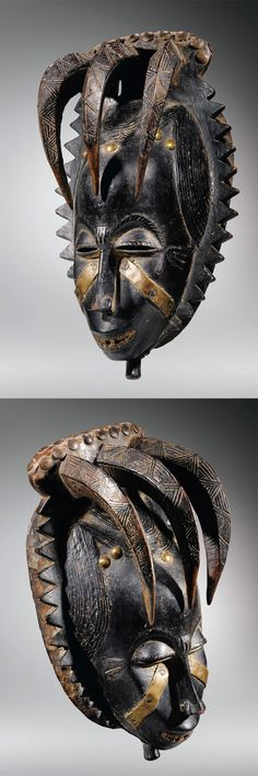 Africa | Mask from the Yaure (Yohourè) people of the Ivory Coast | Wood with dark patina, decorated with brass plates and tacks | ca. 1919 - 1935