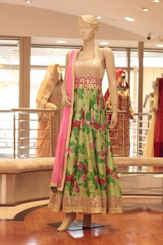 Green and Pink Floral Anarkali Embroidery: Pita and mirror work Fabric : Raw Silk and Net For more information please contact sales@sahil.com and visit us at www.sahil.com