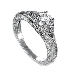 I am pretty much in love with this ring. Spence diamonds vintage style.