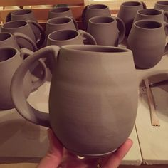 Mugs all trimmed handled and drying for the first firing.  mug love, pottery love, pottery studio, pottery, greenware, pottery, wip, mug love, mug, functional art, coffee, coffee all day, clay, wheel thrown, handmade, handcrafted, maker, ceramic, wheel thrown