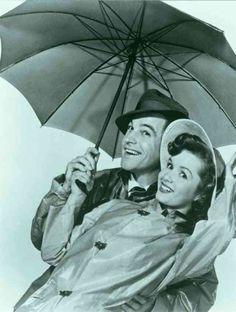 "Gene Kelly & Debbie Reynolds in ""Singing In the Rain what a glorious feeling im smiling again."""