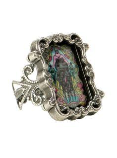 Adjustable metal ring with metal & enamel Ursula cameo design.