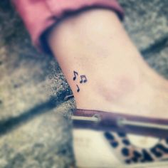 Music notes ankle tattoo