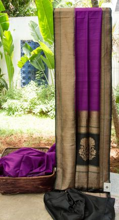 This purple Benares tussar has a lovely texture. The contrasting border and pallu are in black, with elaborate gold zari work making it distinctively special