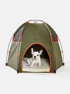 Wagwear Hound Lounge dog tent We get it: No one wants damp dog hair and muddy feet in the tent—that's why we love this personal dog-sized version. It shields your pup from the hot sun and light rain and comes with a removable fleece-covered sleeping pad that you can throw in the washing machine when the camp trip's over. Opt for khaki green or camouflage print, both with orange