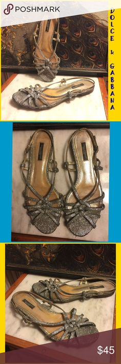 """SZ 8-DOLCE&GABBANA SILVER/ITALIAN LEATHER SANDALS SILVER/ITALIAN LEATHER .25"""" HEEL SANDALS BY DOLCE & GABBANA. BACK BUCKLE STRAP. INTRICATE WEAVE OF TEXTURED SILVER** CHIC & COMFORTABLE. RETAIL $429. OVERALL GREAT PRE-OWNED CONDITION. SZ 8 B (medium/regular width). SLIGHT WEAR WHERE SOLE MEETS INSOLE/TOP TIP OF SHOES (shown). INSOLE ON TOP RIGHT ON RIGHT SIDE-SMALL .5"""" PIECE OF INSOLE HAS COME OFF. CANT SEE WHEN WORN;DOES NOT AFFECT WEAR (shown). PLEASE DO NOT HESITATE TO ASK ANY ?…"""