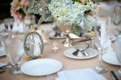 parent's and grandparent's wedding photos on each table