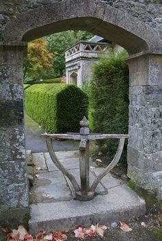 Old turnstyle beside the Clock Arch, Stourhead, Wiltshire