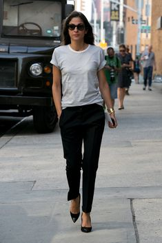 Fashion girls aren't above the basics; they just know how to rock them. T-shirts, skinny black pants, and a classic pump are all among stylish women's must haves.  Source: IMAXTREE / VincenzoGrillo