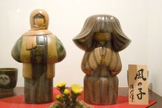 Prize winning pair of kokeshi dolls