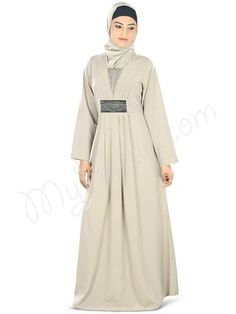 Beautiful Warm Grey Party Wear Abaya | MyBatua.com : Nashitah Abaya!  Style No: Ay-329  Shopping Link: http://www.mybatua.com/nashitah-abaya Available Sizes XS to 7XL (size chart: http://www.mybatua.com/size-chart/#ABAYA/JILBAB) •Pleats around neck line with embroidery patch in center  •Embroidered patch at waist with pleasts •Straight sleeves •Utility pockets on both sides •Matching Square Hijab (100x100 cm approx.) and Band can be bought separately. •Colour: