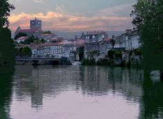 Sunset on the Charente at Saint Savinien . Saint Savinien is beautiful village nestling on the banks of the meandering Charente River in the Saintonge region of France.