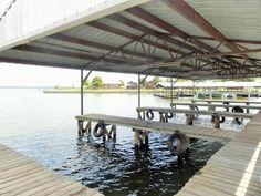 Covered boat slips at Lake Fork Resort Lake Fork, Motel Room, Free Gas, Boat Slip, Rv Parks, Swimming Pools, Pergola, Outdoor Structures, Swiming Pool