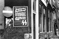 1942. A recruiting poster of the Waffen SS on a building in Amsterdam. About 23,000 Dutch citizens were recruited into the Waffen SS during the Nazi occupation and most of them fought at the east-front. More than 7000 of them died in battle. #amsterdam #1941 #worldwar2 #waffenss