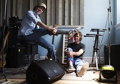 """Jay Ferguson, left, and Chris Murphy, right, of rock band Sloan pose for a photo in their Toronto rehearsal space on August 16, 2012. Now that it's a fixture on lists of the greatest Canadian rock albums of all time, it's easy to forget that Sloan's """"Twice Removed"""" was once reviled. THE CANADIAN PRESS/Michelle Siu"""