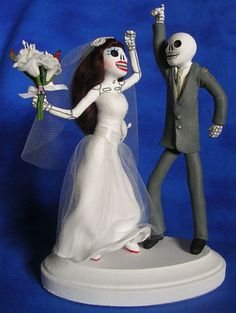 A cheerful Day of the Dead cake topper. #wedding #Day_of_the_Dead