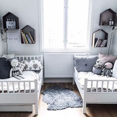 I like this idea for two young boys sharing the same room. For girls: Introduce a few lighter colours in the bedding and maybe the wall mounts.