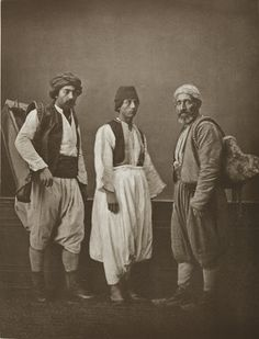 Studio portrait of models wearing traditional clothing from İstanbul, Ottoman Empire. a cabman; a water carrier; and a porter. Date Created/Published: Repository: Library of Congress Middle Eastern Men, Middle Eastern Fashion, Old Pictures, Old Photos, Arabian Nights, Ottoman Empire, Library Of Congress, Studio Portraits, Traditional Outfits