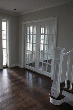 Grey walls, white trim, dark floors.