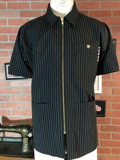 The signature Olvera Barber smock, front brass zipper, pointed collar, 2 chest pocket and 2 hand pockets Barber Clothing, Barber Pictures, Barber Trimmers, Barber Logo, Barbershop Design, Teddy Boys, Men In Uniform, African Wear, Smocking