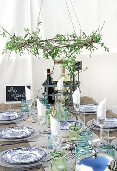 Nice use of Depression Glass Dinner plates under lunch plates & blue / white canning jars for candles.