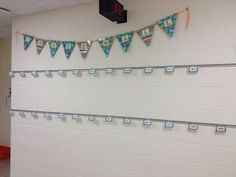"""""""Proud Wall""""- where the kids will display their work using CTP's Dots on Turquoise Pennants."""