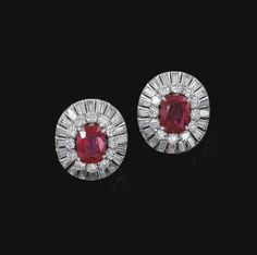 PAIR OF RUBY AND DIAMOND EAR CLIPS, VAN CLEEF & ARPELS. Each set at the centre with a cushion-shaped ruby weighing 3.79 and 3.94 carats respectively, within a border of brilliant-cut and baguette diamonds, signed Van Cleef & Arpels and numbered, French assay and maker's marks.