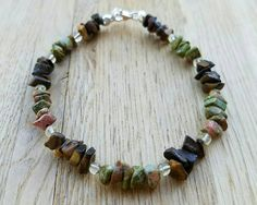 Brown & gold tones of tigereye, with the green & pink of unakite, lend an earthy feel to this fallen leaves inspired bracelet.