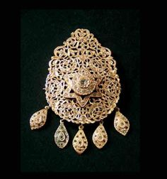 """Morocco   """"Tabaa"""" brooch; openwork gold and diamonds   Fez or northern Morocco   Early 20th century   Est. 25,000 to 28,000 Dh (Nov. '11)"""