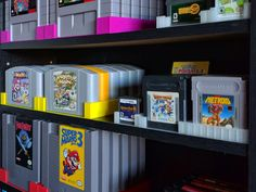 After starting my Nintendo collection, I decided I wanted a way to store all of my games on my DVD shelf, while keeping them nicely on display.  With a bit of measuring and searching for inspiration on Thingiverse, I came up with a solution. Each large cartridge rack (NES, SNES, Genesis, N64) holds six game cartridges.  Each small cartridge rack (GB/GBA, DS/3DS) holds twelve game cartridges.  Racks are the same depth as a standard DVD case, so they work well on DVD shelves or as bookends. A…